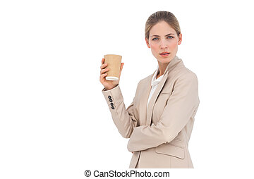 Serious businesswoman with coffee cup