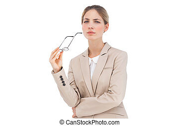 Serious businesswoman holding glasses