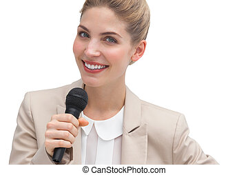 Businesswoman public speaking with microphone
