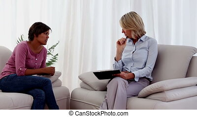 Therapist listening to patient telling her problems