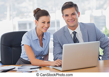 Smiling business people