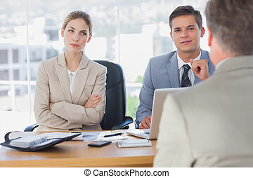 Happy business people interviewing business man in the...