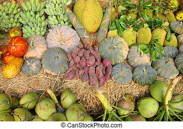 Pile of tropical fruits and vegetables