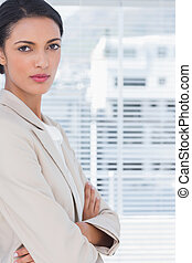 Brunette businesswoman with arms crossed