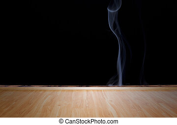 Smoke on black background and and wooden floor