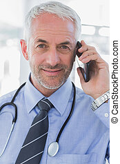 Cheerful doctor calling - Portrait of a cheerful doctor...
