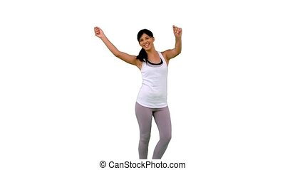 Fit woman dancing on white background in slow motion