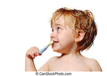 Brushing Teeth - A happy young boy brushes his teeth