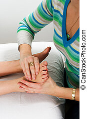 Closeup of teenagers foot during massage treatment at health...