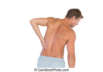 Man rubbing his back because of a back pain