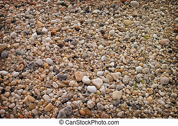 Beach stones - a close up detail of stones on an atlantic...