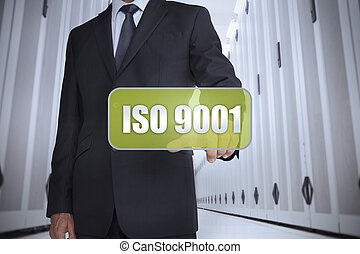 Businessman selecting a green label - Businessman in a data...