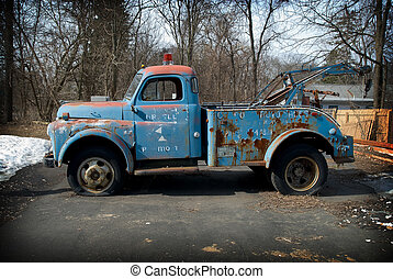 Vintage tow truck in a parking lot