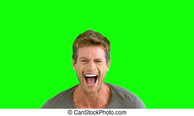 Man laughing on green screen in slow motion