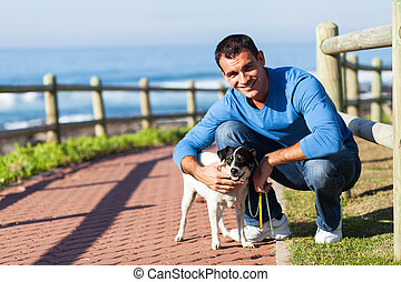 young man with his pet dog - cheerful young man with his pet...