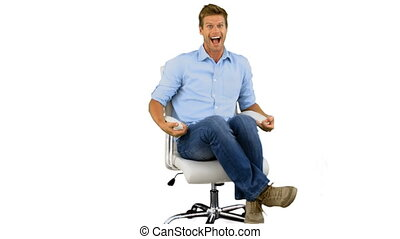 Smiling man turning on swivel chair on white background in...