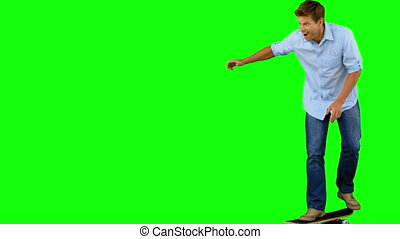 Man skating on green screen in slow motion