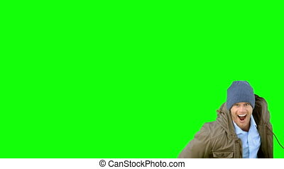 Man jumping and turning on green screen in slow motion