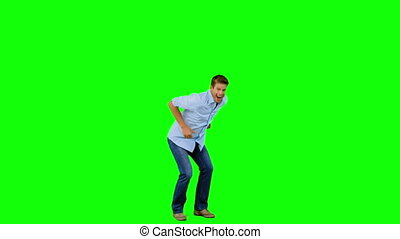 Man jumping and gesturing on green
