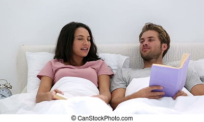 Couple talking about the books they