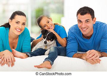 loving family lying on bed