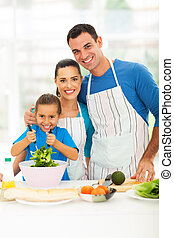 beautiful young family cooking at home - beautiful young...