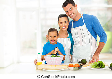 adorable young family cooking at home - adorable young...