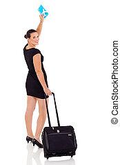 cheerful businesswoman waving goodbye