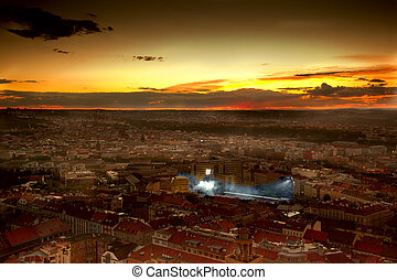 Epic sunset over city with football stadion