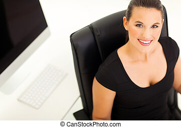 overhead view of businesswoman in office - overhead view of...