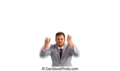 Excited businessman jumping and cheering on white background...