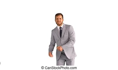 Businessman dancing and smiling on white background in slow...