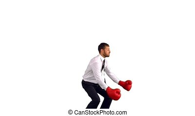 Businessman in boxing gloves jumpin