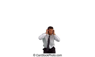 Businessman jumping up and listening to musicand in slow...
