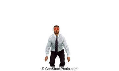 Businessman jumping up wearing swimming goggles in slow...