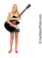 teen girl holding guitar