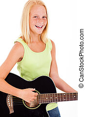 pre teen girl playing a guitar - laughing pre teen girl...