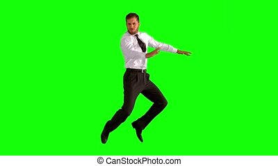 Businessman jumping up  on green screen in slow motion