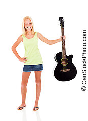 pre teen girl showing her guitar - cheerful pre teen girl...