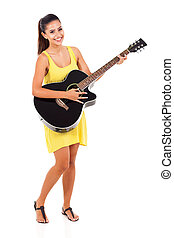 woman playing guitar - beautiful woman playing guitar...