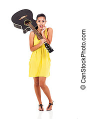 surprised young woman with a guitar - surprised young...