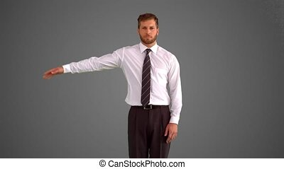 Businessman body popping on grey ba