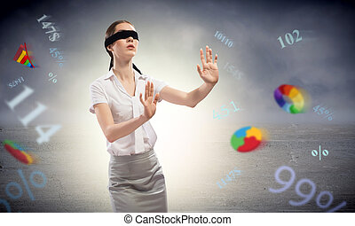 young blindfolded woman can not find a way of flying charts...