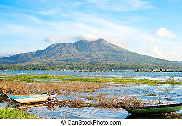 Volcano Batur - Fishing boats in front of volcano Batur at...