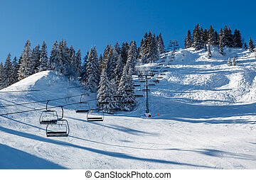 Sunny Ski Slope and Ski Lift near Megeve in French Alps,...