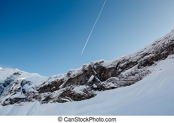 Mountain Peak and Airplane Trail near Megeve in French Alps,...