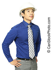 Thinking Businessman  - A man wearing a hardhat looking up