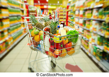 Cart with products - Image of cart full of products in...