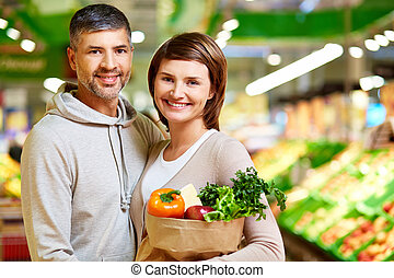Cheerful consumers - Image of happy couple with healthy...
