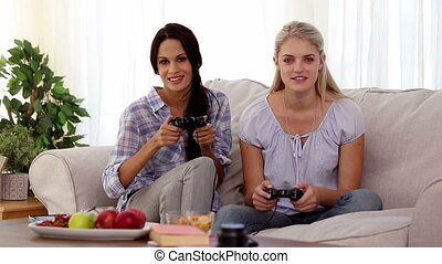 Friends playing video games togethe